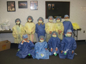 A group of children dressed in scrubs
