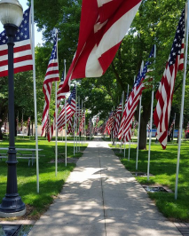 sidewalk with American flags every few feet on both sides