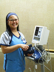 FCMC employee smiling with equipment